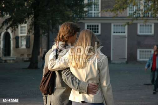 istock couple in love walking while holding eachother 89465565