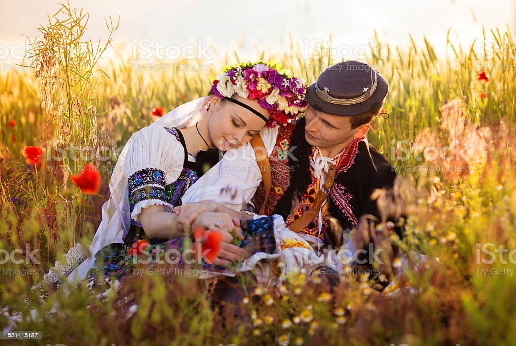 Couple in love with traditional folk costumes stock photo