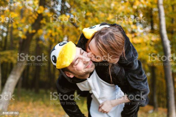 Couple in matching penguin pajamas in autumn forest picture id838048160?b=1&k=6&m=838048160&s=612x612&h=epftnbvz8nhe6qluysddtd4m sqrmh2mv  m8rhf0bi=
