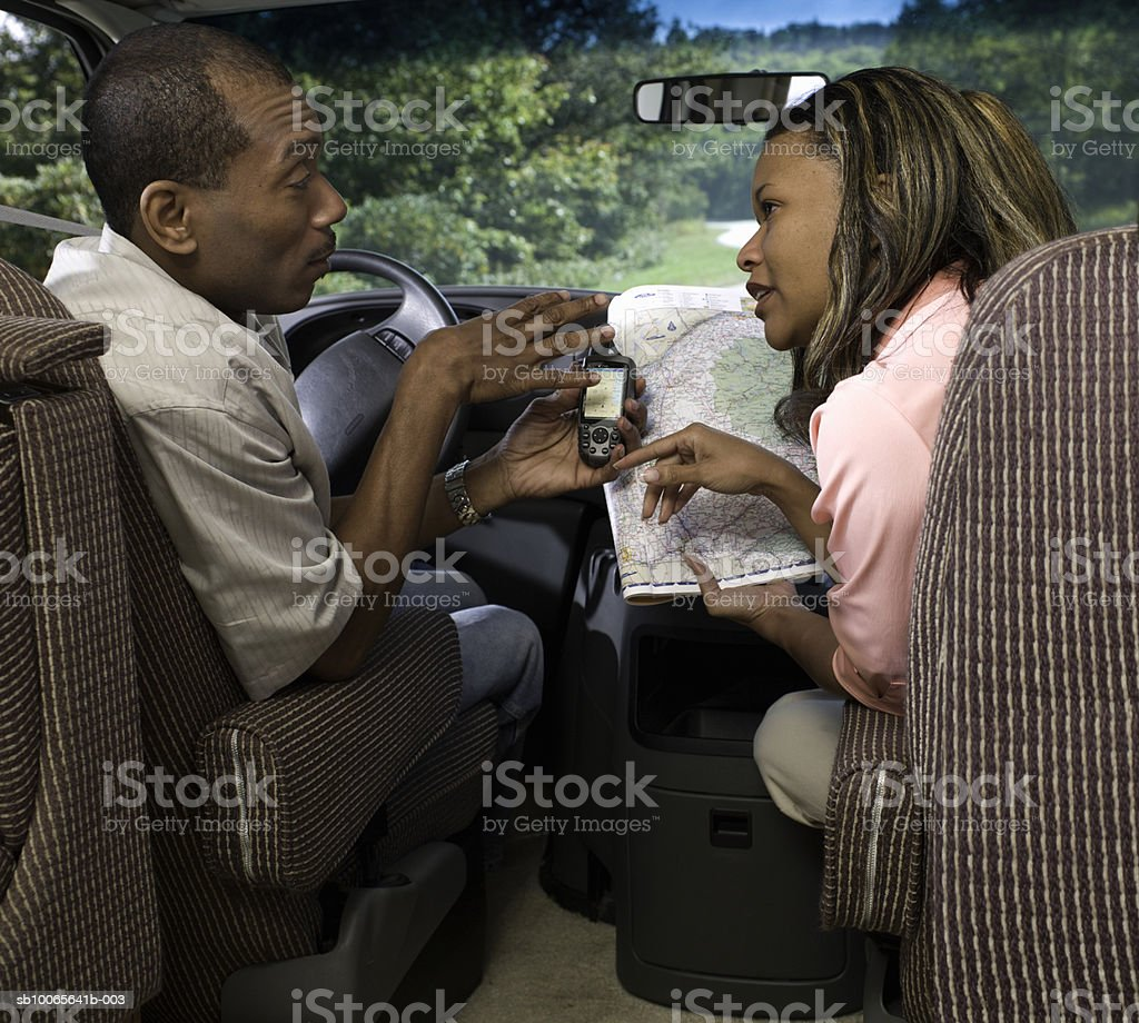 Couple in motorhome, reading map royalty-free stock photo