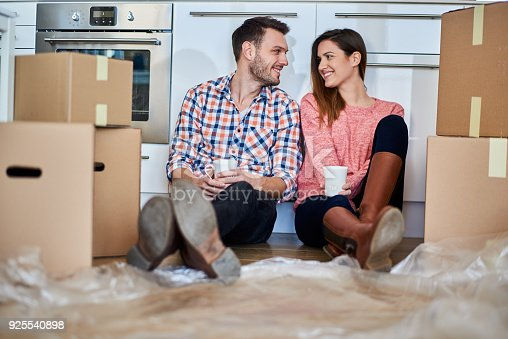 istock Couple in new apartment 925540898