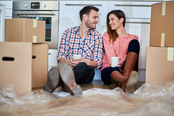 Couple in new apartment stock photo
