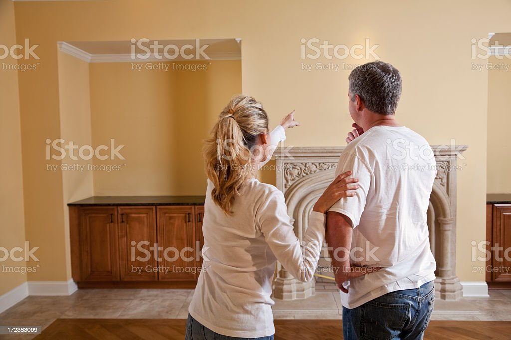 Couple in new home making decisions stock photo