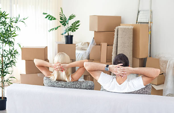 Couple in new home, resting stock photo