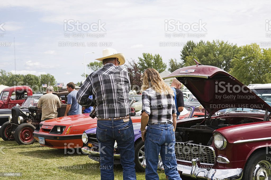 Couple in Plaid at Classic Car Show stock photo