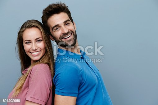 istock couple in polo shirts, portrait 621502956