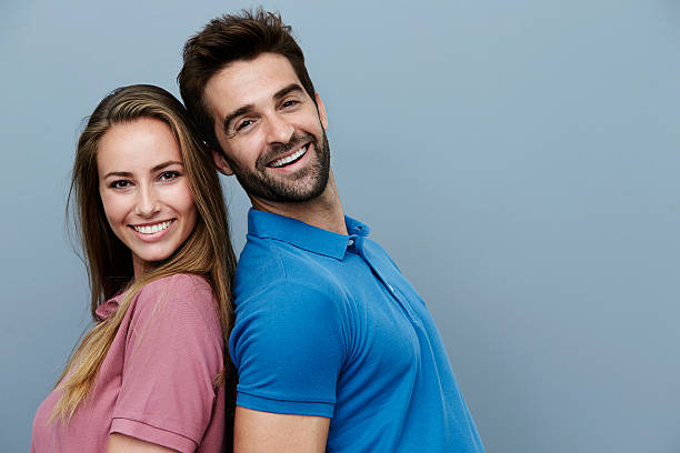 couple in polo shirts, portrait stock photo