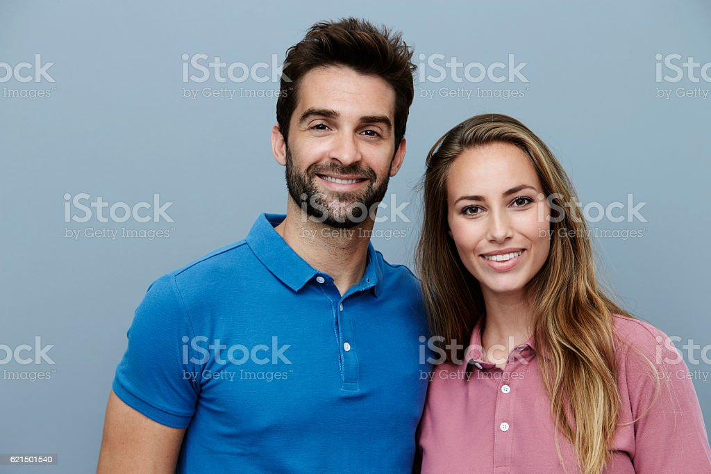 Couple in polo shirts smiling for camera foto stock royalty-free