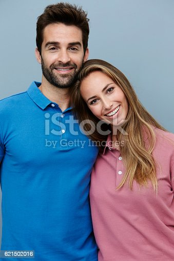 621502402 istock photo Couple in polo shirts, smiling 621502016