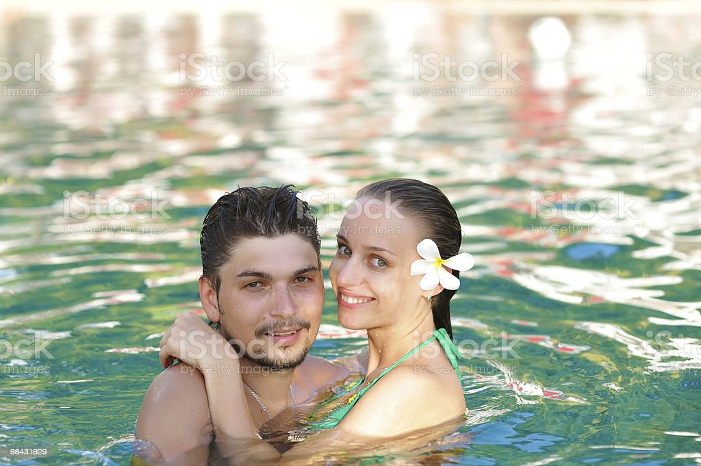 Couple in pool royalty-free stock photo