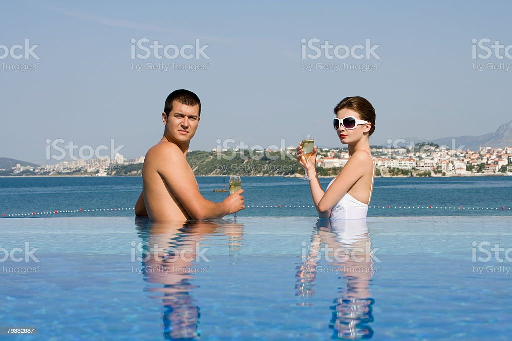 Couple in pool with champagne royalty-free 스톡 사진