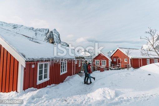 Young Caucasian heterosexual couple  in Reine village in Lofoten Islands, Norway