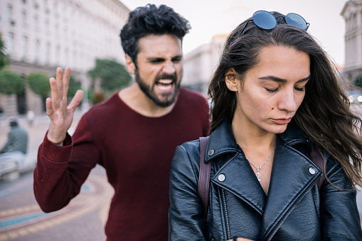 Bearded man shouting at his girlfriend