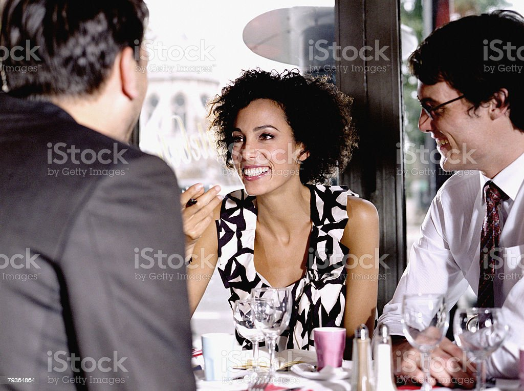 Couple in restaurant with man royalty-free stock photo