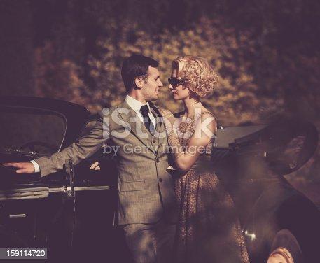 Couple near a retro car outdoors