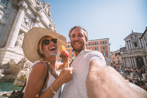 Couple in Rome taking selfie with gelato