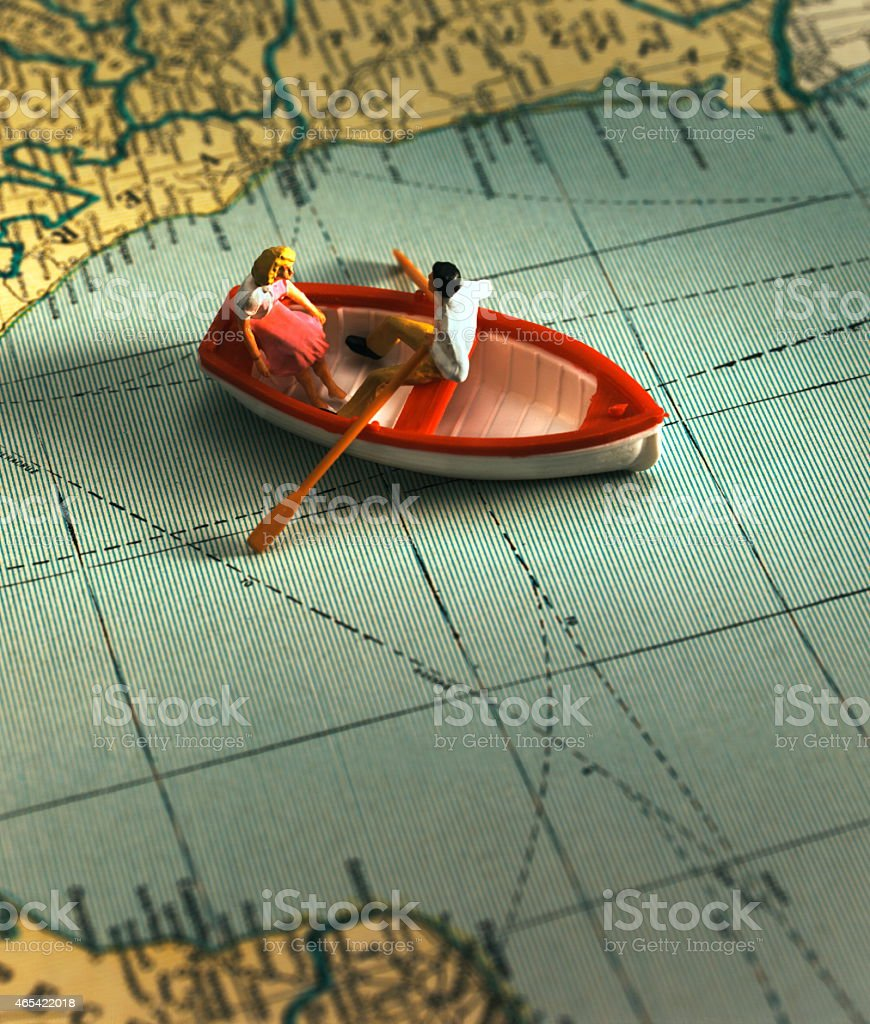 Couple in Rowboat on Map stock photo
