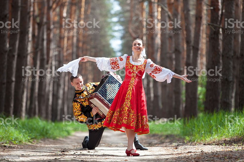 Couple in russian traditional dress on nature stock photo