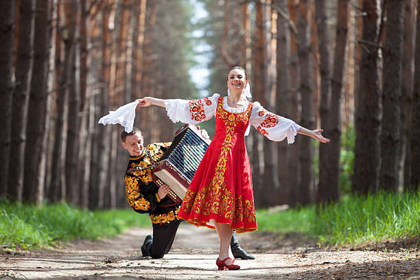 couple in russian traditional dress on nature - russia stock pictures, royalty-free photos & images