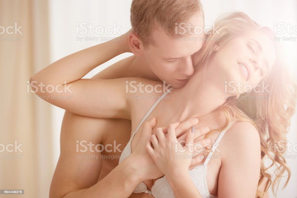 Couple in sexual embrace stock photo