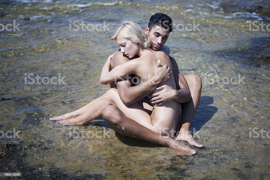 Couple in shallow sea royalty-free stock photo
