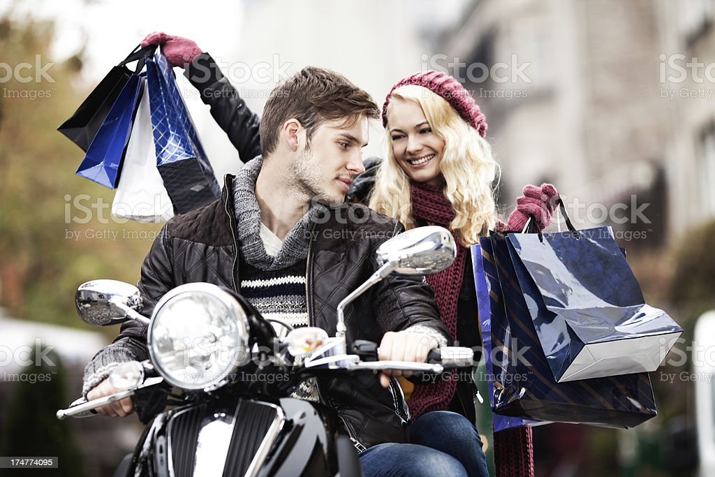 Couple in shopping on scooter royalty-free stock photo