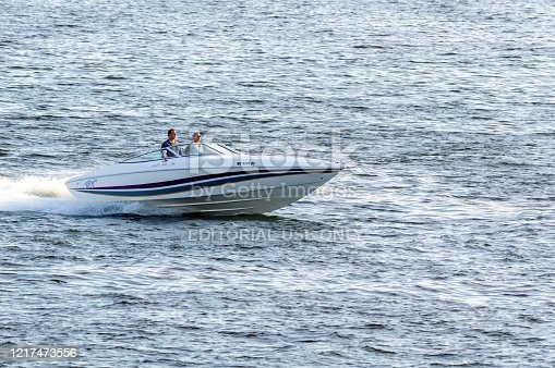 New Bedford, Massachusetts, USA - September 2, 2018: Sport boat gliding across chop in New Bedford outer harbor in early evening