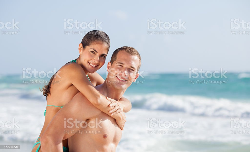 Couple in swimware holding each other stock photo