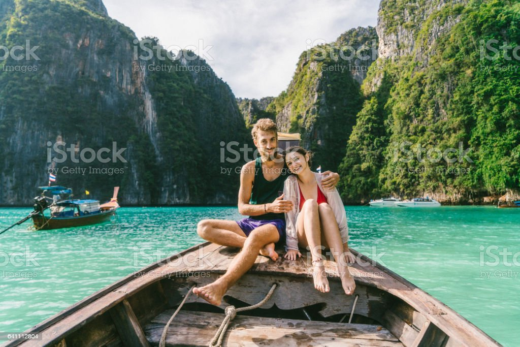 Couple in Thai Taxi Boat stock photo