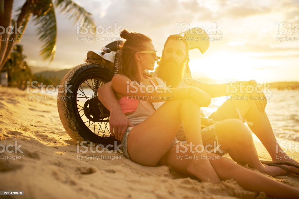 couple in thailand with motorbike watching sunset royalty-free stock photo