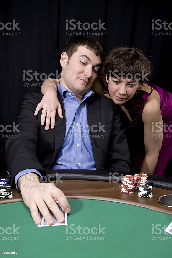 Couple in the casino royalty-free stock photo