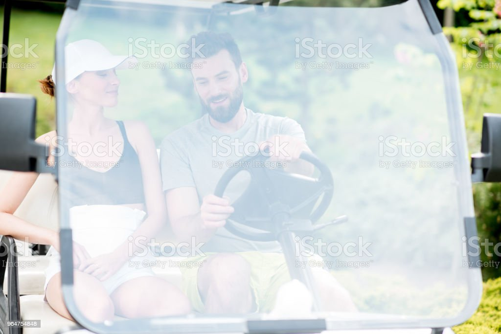Couple in the golf cart royalty-free stock photo