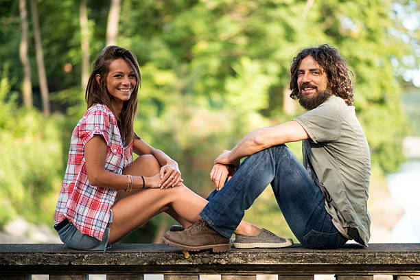 couple in the park: together in love - italienische lebensart stock-fotos und bilder