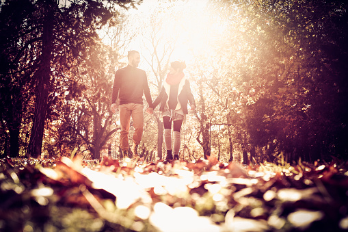 Couple in the park. Walking trough nature.