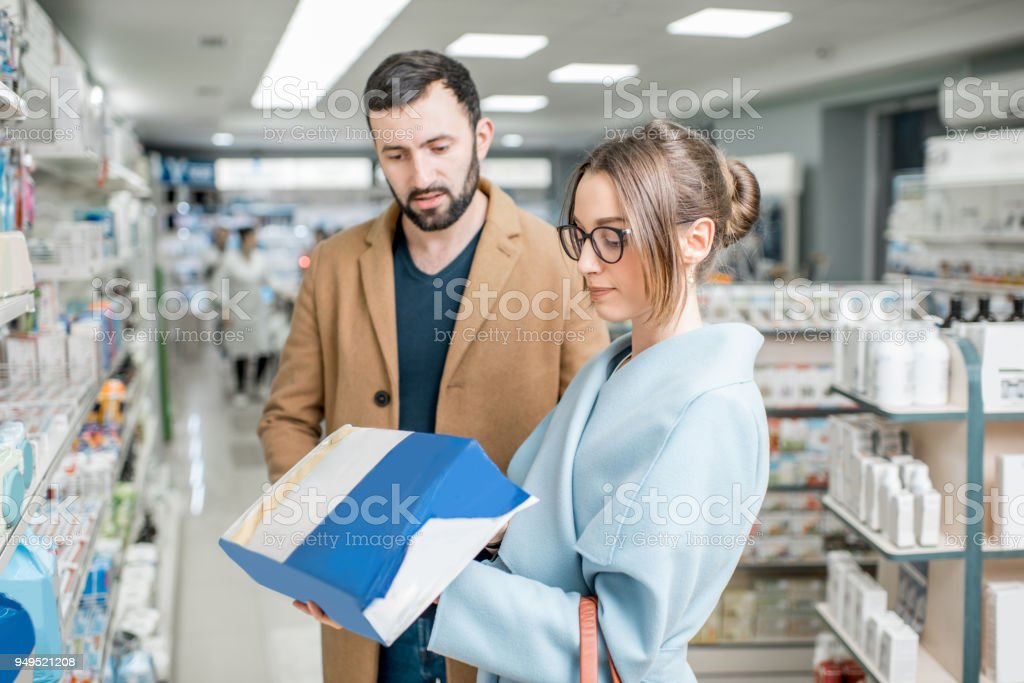 Couple in the pharmacy store stock photo