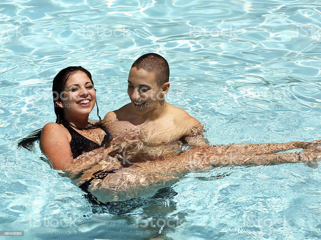 Couple in the pool royalty-free stock photo