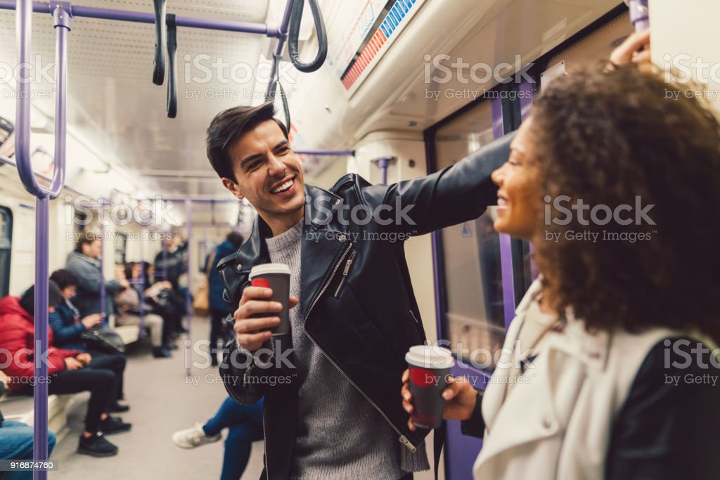 Couple in the subway train stock photo