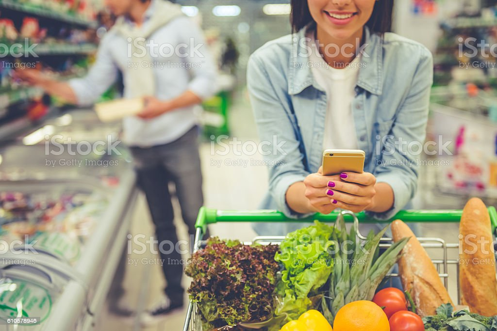 Couple in the supermarket royalty-free stock photo