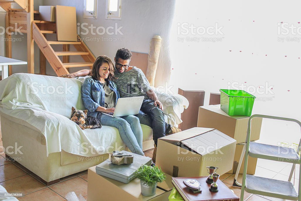 Couple in their new home stock photo