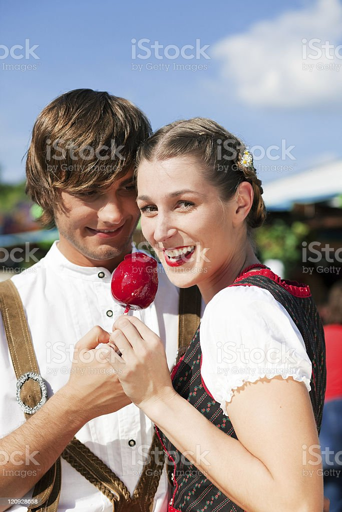 Couple in Tracht on Dult or Oktoberfest royalty-free stock photo