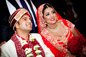 istock Couple in traditional Asian wedding outfits smiling 472079555
