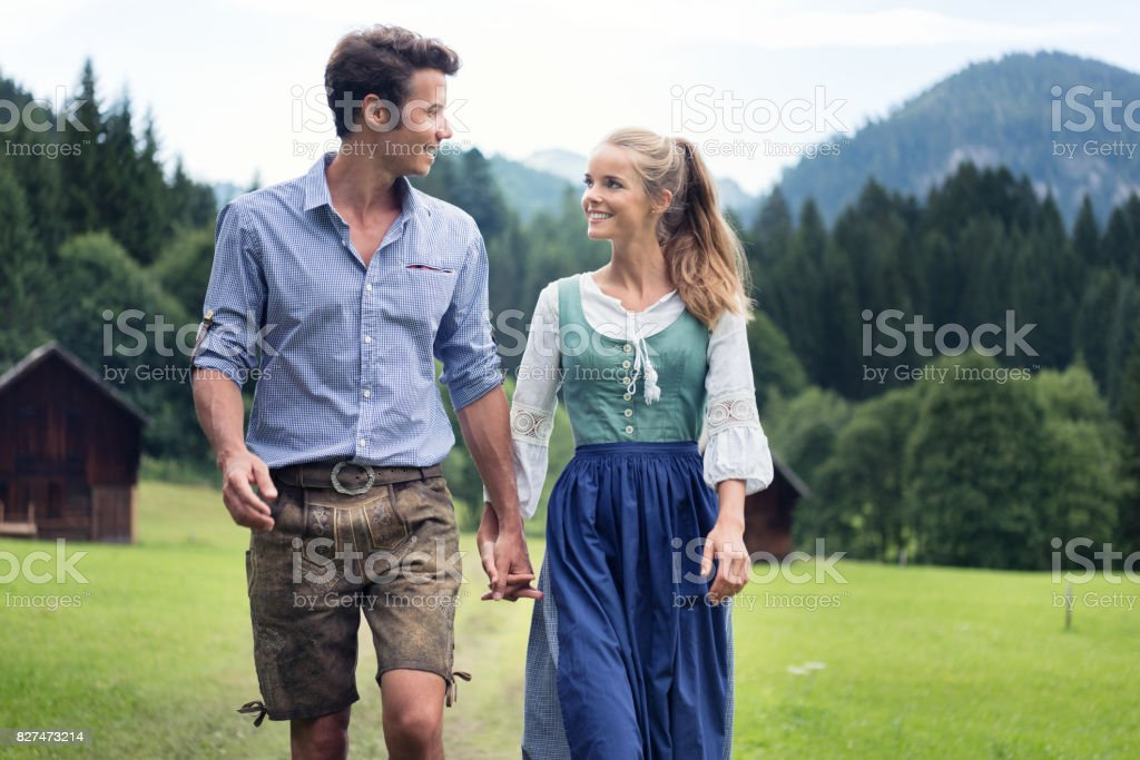 Couple in traditional Lederhosen and Dirndl Tracht, Austria stock photo