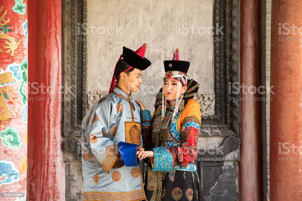 Couple in traditional Mongolian outfit. stock photo