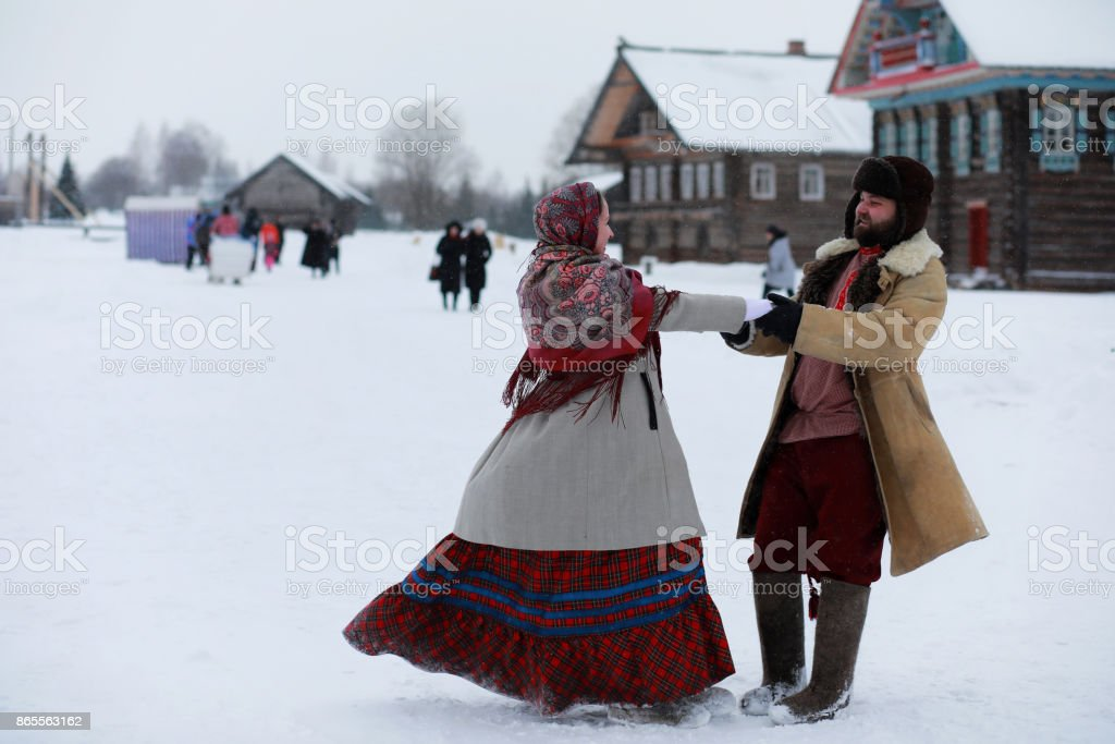 Couple in traditional winter costume of peasant in russia stock photo