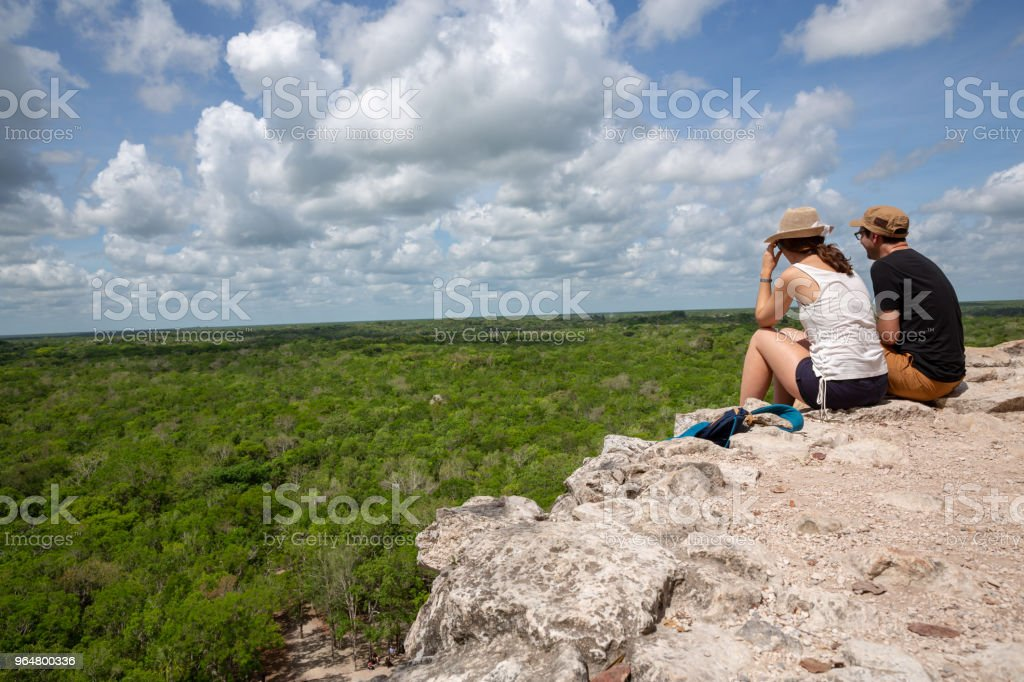 Couple in travel on the summit of Mayan Pyramid in Mexico royalty-free stock photo