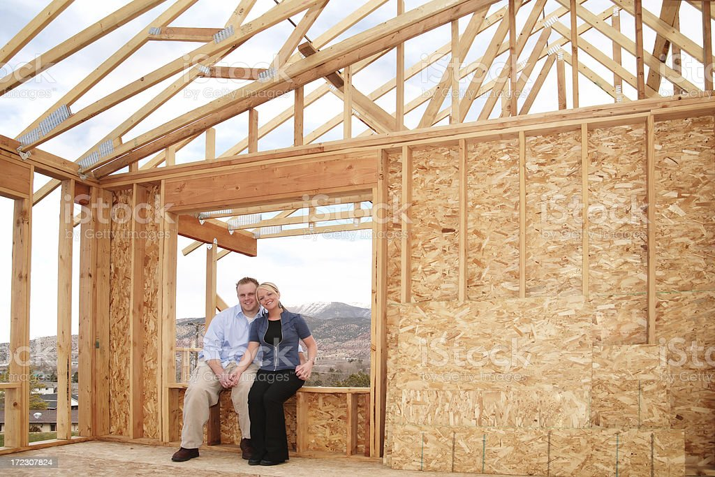 Couple in Unfinished House royalty-free stock photo