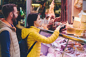 Couple shopping food and making contactless payment with smartphone