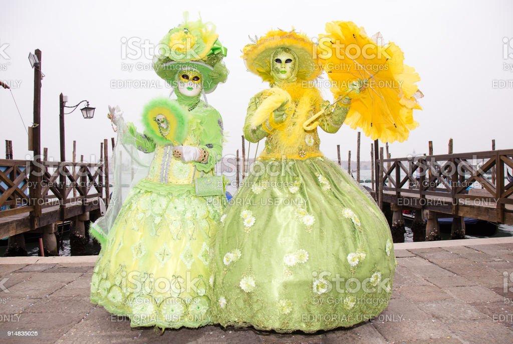 Couple in Venetian Masks - Venice Carnival with Gondolas stock photo