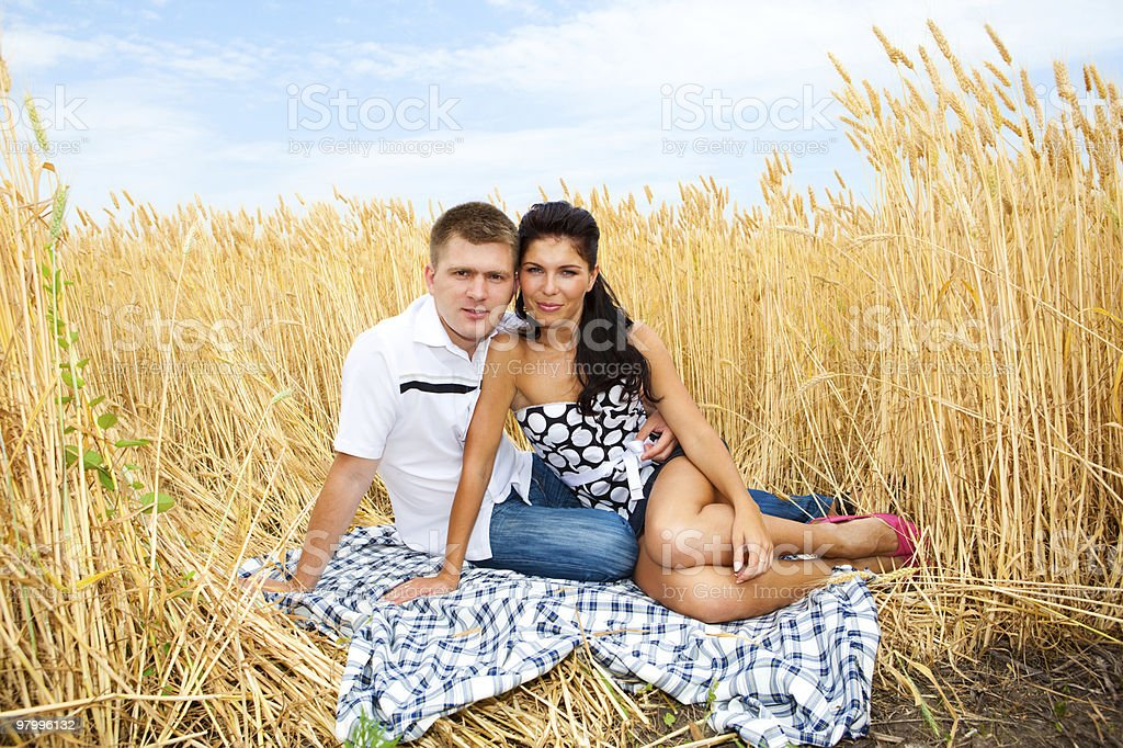 Couple in wheat royalty-free stock photo