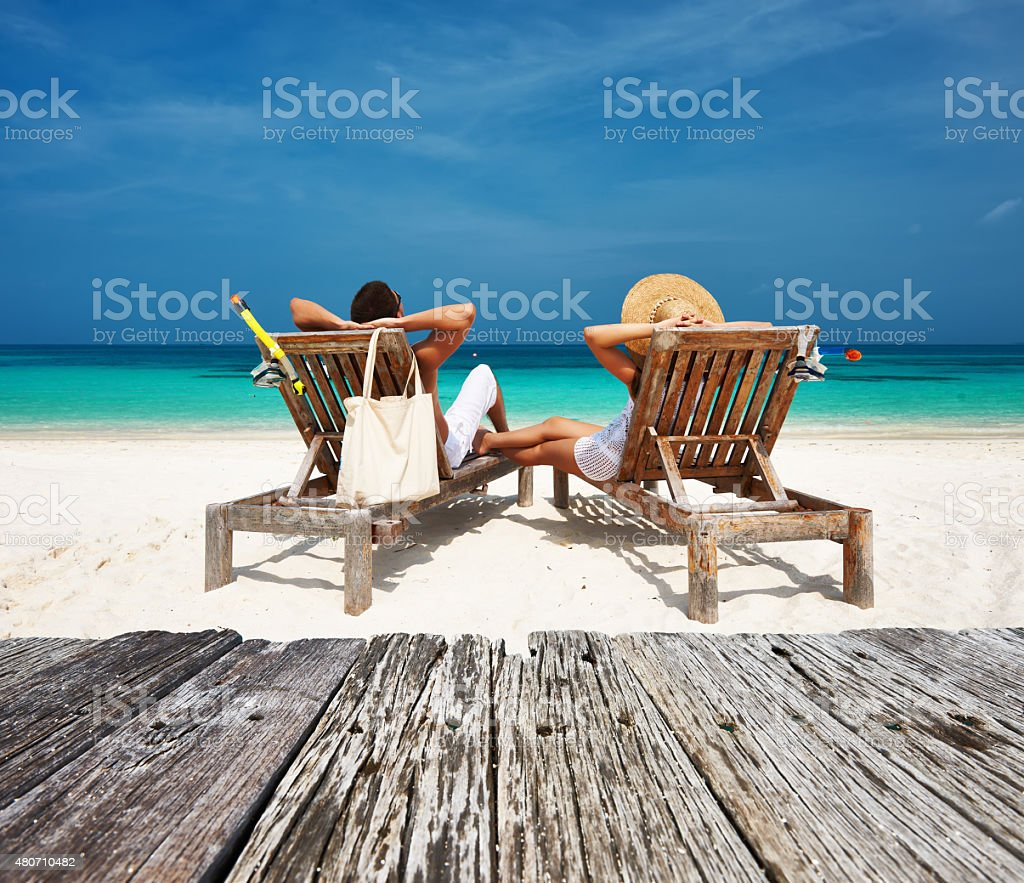 Couple At The Beach Stock Image Image Of Caucasian: Couple In White Relax On A Beach At Maldives Stock Photo